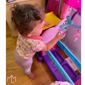 9-12 month baby early evening playtime playing with toys