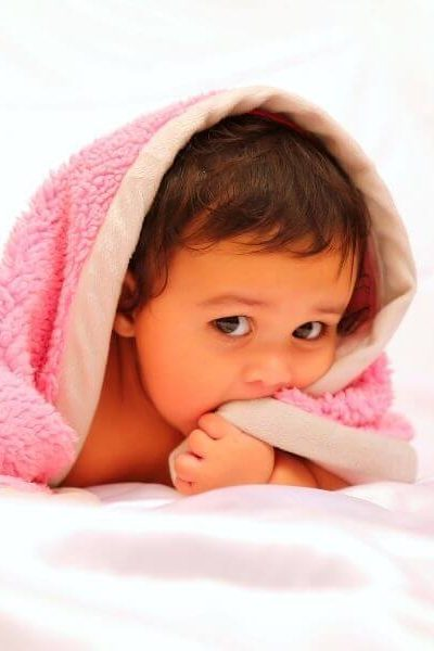 Baby bath routine: baby in pink towel