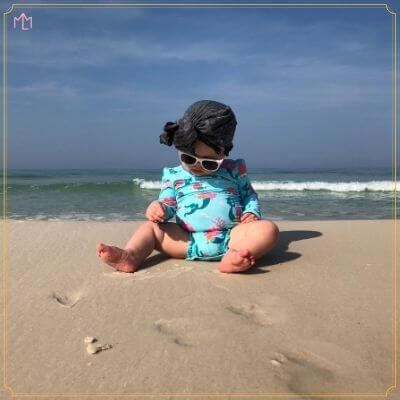 Baby in bathing suit: summer diaper bag essentials