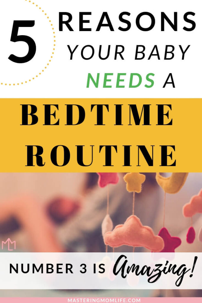 5 Reasons Your baby needs a bedtime routine. Mom holding baby in bed with mobile.