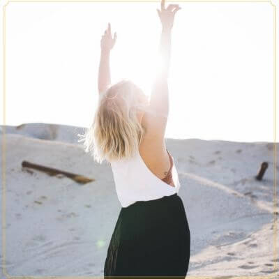 Mom Glow Freedom | Image of woman with hands in the air