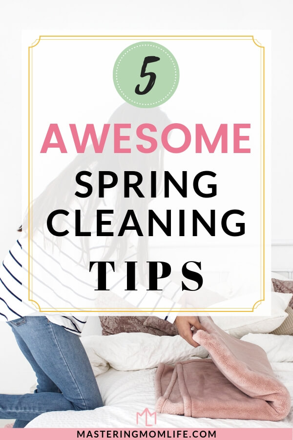5 Awesome Spring Cleaning Tips| Image of woman folding blankets on bed