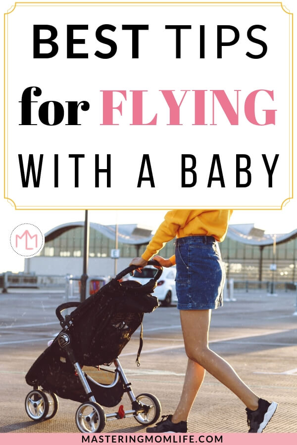 Best Tips for flying with a baby | Image of woman pushing stroller in parking lot